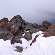 图库照片: Rocks in snow against clear blue sky, Caucasus mountains