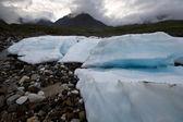 Wild landscape in Russia. Ice glacier blocks,stones,fog. — Stock Photo