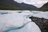 Wild landscape in Russia. Ice glacier blocks,stones. — Stock Photo