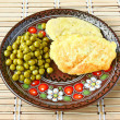 Potato pancakes with a green pea — Stock Photo