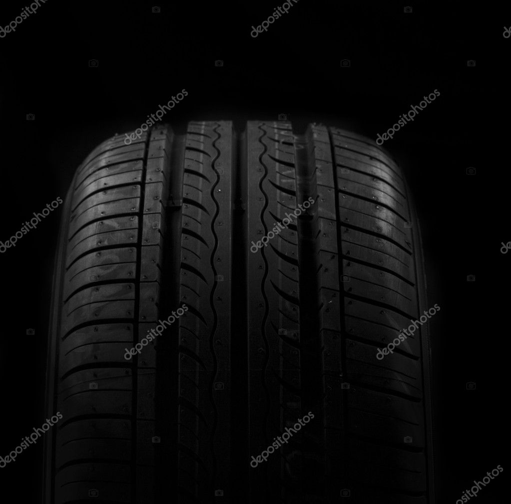 Car tire on black background — Stock Photo #5448646