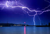 Lightning above the lake — Stock Photo