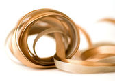 Gold and silver ribbons — Stock Photo