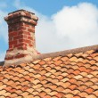 Tile roof with brick chimney — Stock Photo