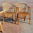 A pair of wicker chairs and table — Stock Photo