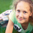 A young girl on green grass - Foto Stock