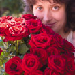 A young woman and roses — Stock Photo