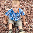 A boy on stones — Stock Photo