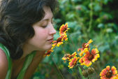 A young woman and flowers — Stock Photo