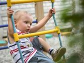 A little boy on playground — Stock Photo