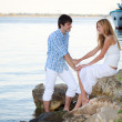 Сouple on the riverbank — Stock Photo