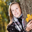 Girl in autumn wood — Stock Photo