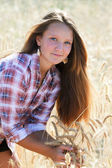 Girl farmer in a field — Stock Photo