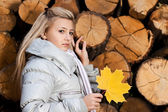 Girl with maple leaf — Stock Photo