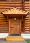 Entrance into a wooden house — Stock Photo
