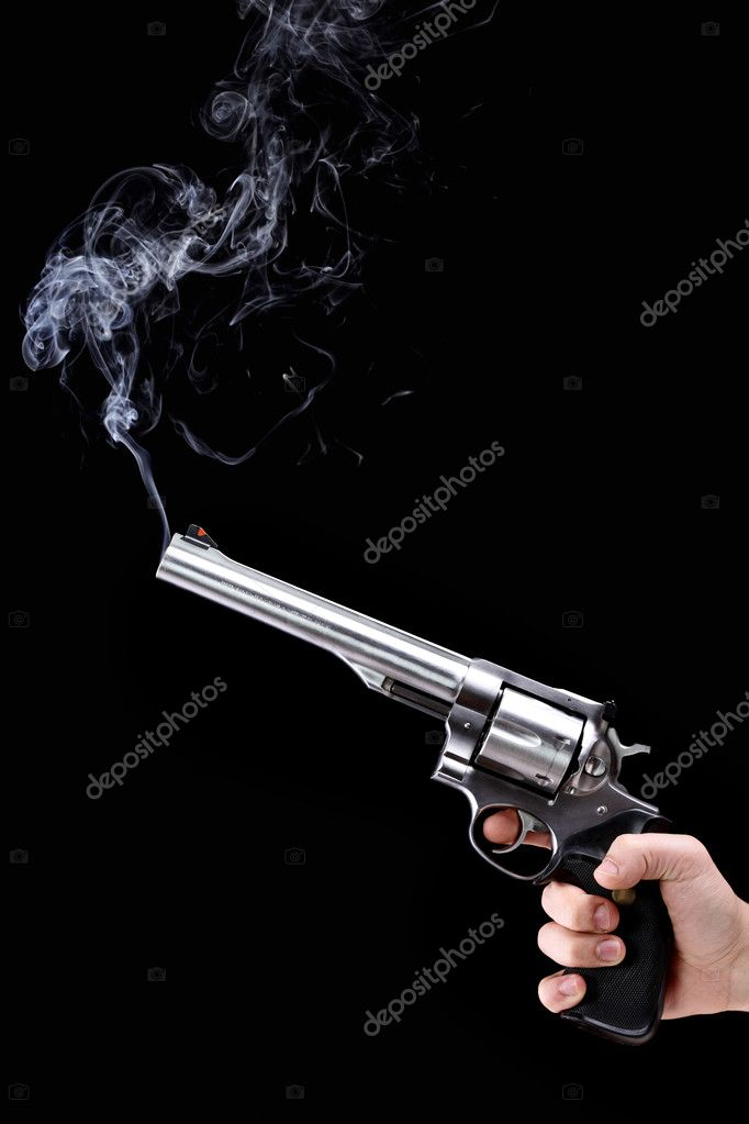 Hand holding a revolver with smoking barrel, against black background — Stock Photo #5388054
