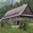 Old traditional house in the mountains - Stock Photo