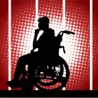 Young boy in a wheelchair — Stock Vector