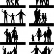 Silhouettes Of Parents With Children — Stock Vector #6602642