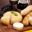 Stock Photo: Cheese, wine and other tasty stuff on wooden table