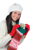 Young Woman with Christmas Present and Stocking — Stock Photo