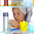 Woman Looking in Medicine Cabinet — Stock Photo