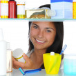 Woman Looking in Medicine Cabinet - Stockfoto