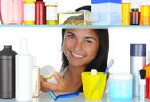 Woman Looking in Medicine Cabinet — Stockfoto
