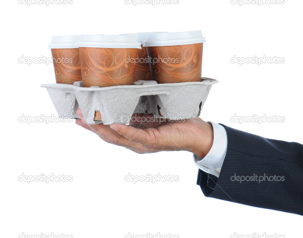 Business man holding a take out tray of disposable coffee cups. Arm only in horizontal format isolated on white. — Stock Photo #5662818