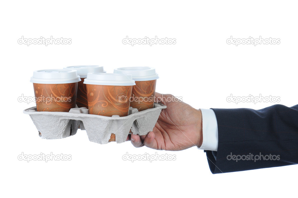 Business man holding a take out tray of disposable coffee cups. Arm only in horizontal format isolated on white. — Stock Photo #5662819