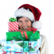 Young Woman holding stack of Christmas Presents — Stok fotoğraf