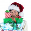 Young Woman holding stack of Christmas Presents — Stock fotografie