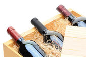 Wine Bottles in wooden crate — Stock Photo