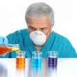 Stock Photo: Scientist Pouring Liquids into Beakers