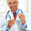 Doctor with test tube in clinic - Stock Photo