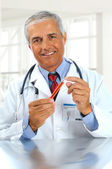 Doctor with test tube in clinic — Stock Photo