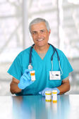 Doctor with prescription medicine in clinic — Stock Photo