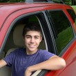New teenage driver sits in his new car — Stock Photo