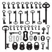 Silhouettes van oude sleutels — Stockvector