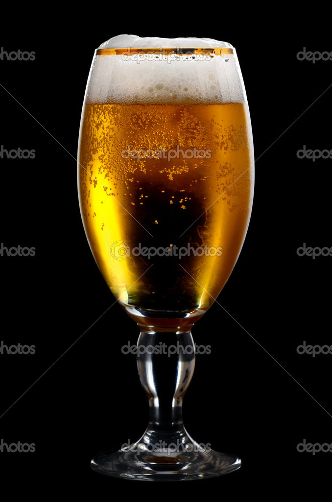 Beer into glass on a black background — Stock Photo #5459755