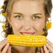 Woman eating corn-cob — Stock Photo