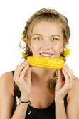 Woman eating corn-cob — Stock Photo