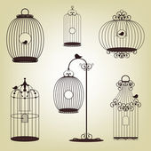 Set of vintage bird cages — Vector de stock