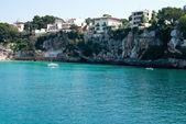 Yacht near rocky shore in Porto Cristo bay, Majorca, Spain — Photo