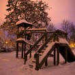 Playground covered in snow at night on long exposure — Stock Photo