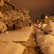 Calm snowy footpath at night on long exposure - Stock Photo