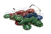 Gambling chips and eyglasses — Stock Photo