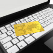Gold credit card on laptop — Stock Photo #5447009