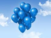 Blue balloons on a blue sky — Stock Photo