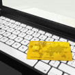 Gold credit card on laptop — Stock Photo